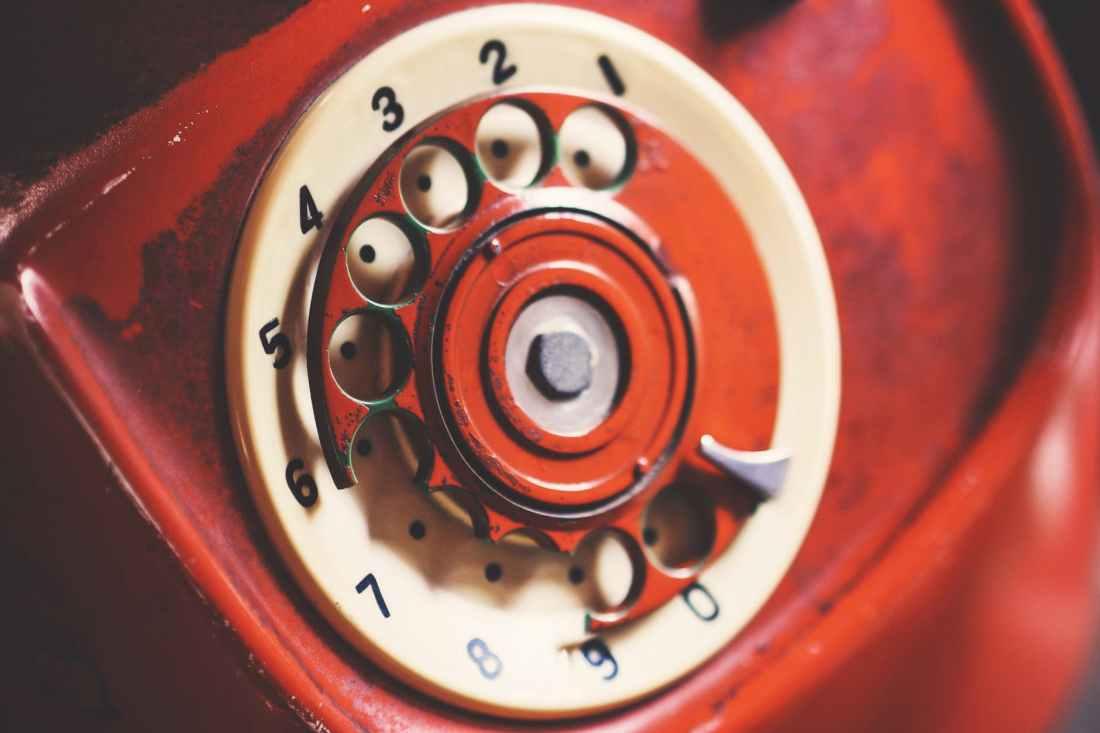 close up photo of rotary telephone