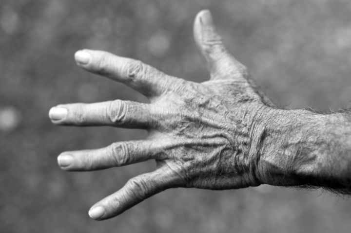 hand wrinkles black and white elderly woman