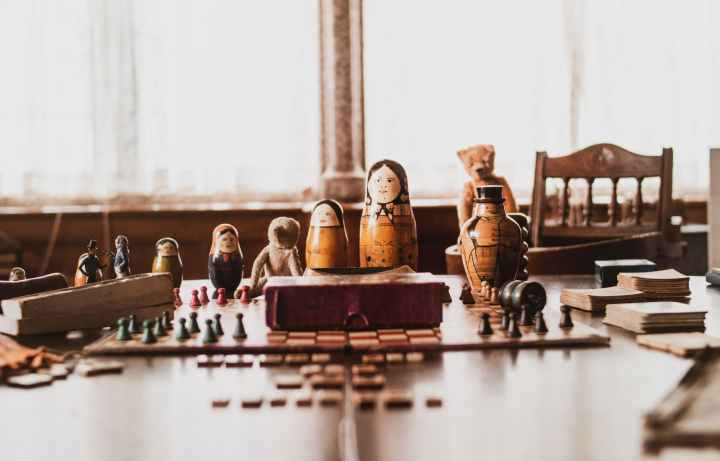 brown and black nesting doll on brown wooden table