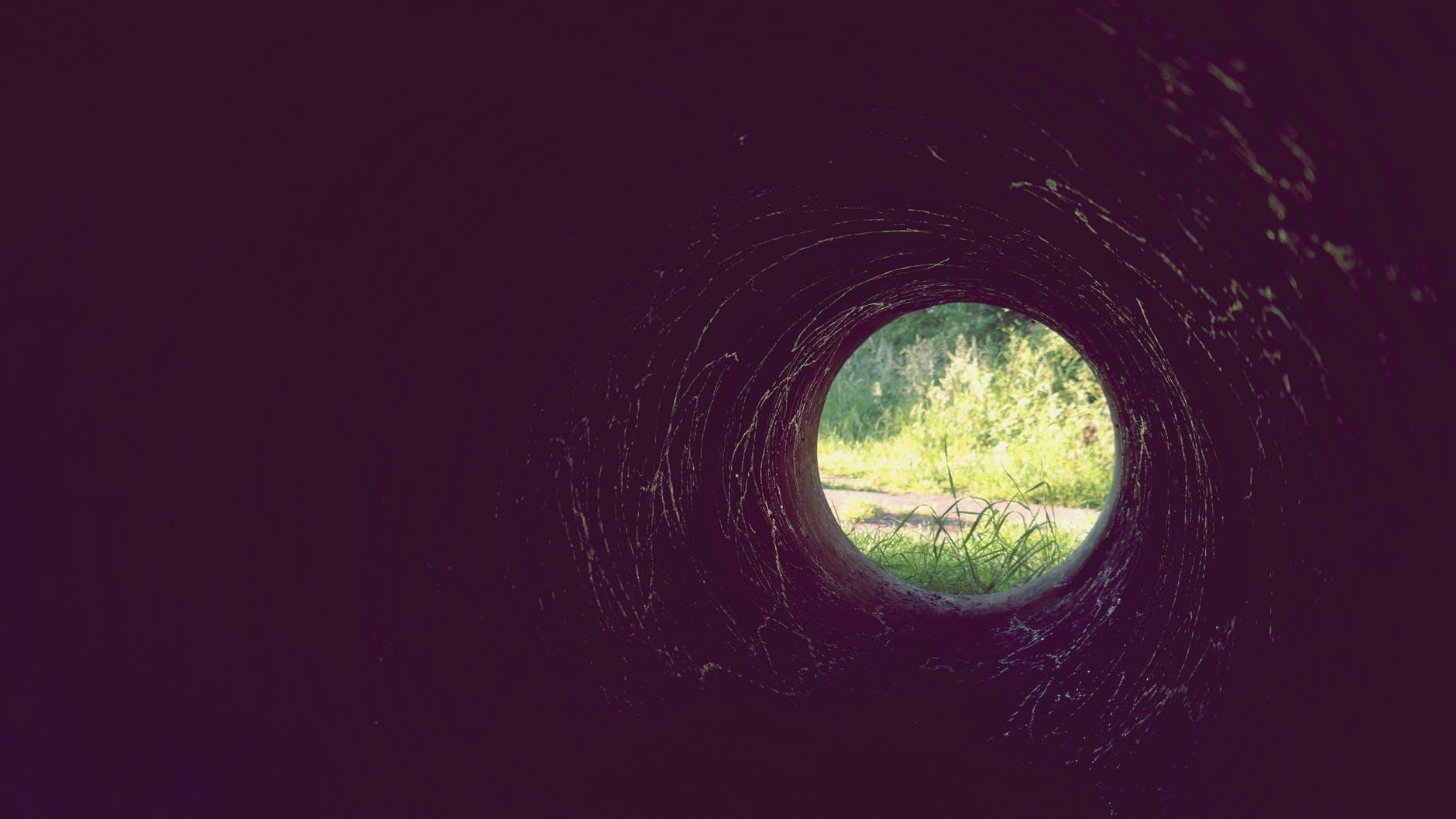 ball shaped dark grass hole