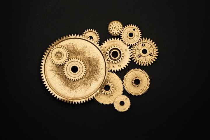 photo of golden cogwheel on black background